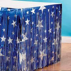 The Blue with Silver Stars Table Skirting will accent your tables with the silver stars on a metallic blue foil skirt.