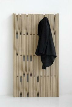 flat, fold out coat hooks. Very versatile hanging space. Would look cool with hooks painted in different hues.