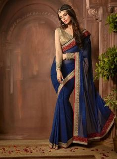 #Blue and #Gold Georgette Printed Embroidered #Saree Features georgette saree with matching blouse.