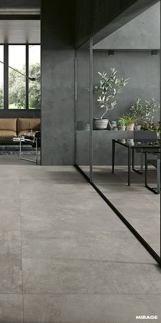Outdoor | Concrete Look Tiles | Discover the new #Glocal collection by Mirage: 6 neutral shades ranging from white to anthracite, with warm and cold shades of grey that have the ability to further accentuate the chosen #solutions of #furniture and #design. #evomirage #porcelaintiles #italiantiles #concreteeffect #concretetiles #concretelook #concretedesign #outdoor #outdoordecor #outdoordesign #exteriordesign #outdoortiles #design #interiordesign #designers #architecture
