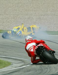 Max Biaggi loses control of his Camel Pramac Pons Honda at high speed just ahead of Troy Bayliss. Biaggi had been the fastest man on track at that point.