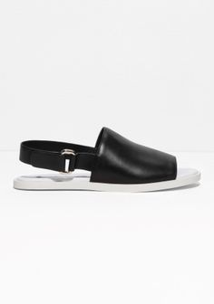 Relax your look with these comfortable and clean-cut ankle strap sandals, crafted from leather.
