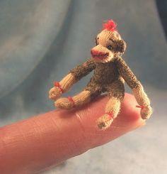 A tiny sock monkey. Who can resist?