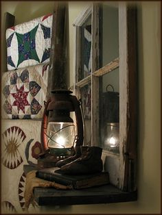 Love the quilts on the ladder and window shelf with lantern    I have the ladder, quilts, lanter and window. IM SO GOING TO DO THIS :)