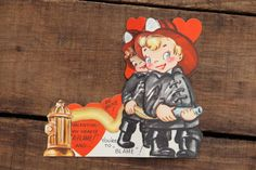 This is a 1950s Vintage Valentine in great condition, it appears to be unused. It has adorable little boy and girl fireman on the front. The