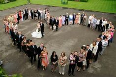 Wedding pic with heart made of family members