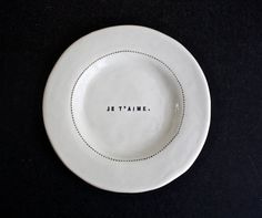 Series of French phrase dishware