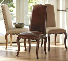 Pottery Barn. Calais Chairs. Antique bronze-finished nail heads outline the seat and back of this chair, providing a handsome contrast to the rich upholstery.