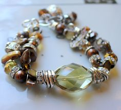 BLACK FRIDAY SALE fall in bloom citrine wire wrapped heshi pearl golden bold statement charm bracelet. $54.39, via Etsy.