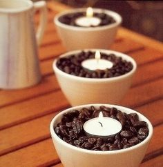 Fill small bowls with coffee beans and place a votive candle inside. when the candle burns the room will smell like coffee
