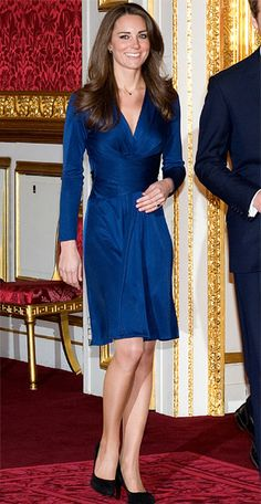 November 16, 2010  Other than her wedding dress, this is one look you won't forget. To announce her engagement to Prince William, she chose a sapphire wrap dress by Issa, a color that matched her sparkly new ring. The dress sold out immediately in stores after she wore it.