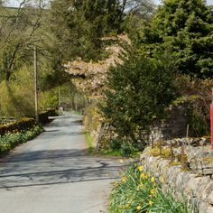 A red telephone box on a country lane at Wath,Nidderdale,North Yorkshire,England.