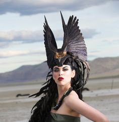 My mother would have a seizure if I told her I loved this idea.  The Falconer Enchantress Feather Headdress by RoosterBaby22, $585.00