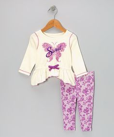 Packed with spunky colors and fun-loving details, this peppy pair is perfect for any stylish sprite! The tunic boasts a ruffled hem and a bow up front, while the floral leggings feature a hint of stretch for enhanced flexibility.