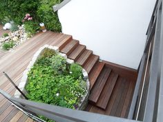 Terrasse bauen Treppe um Ecke