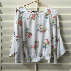 Floral shirt Floral top gathered at waist. Bell quarter length sleeve. Forever 21 Tops Blouses