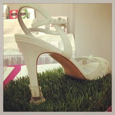 Genius idea — Solemates prevent heels from sinking into the grass at an outdoor wedding!