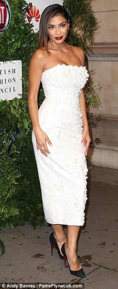 What a stunner: Nicole, who performed on the night, looked incredible in a very low-cut strapless white dress which had floral embellishments running throughout