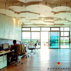 Purshottam Office - Where large discs of perspex are used as ceiling lights, giving the whole room a dramatic three dimensional affect.
