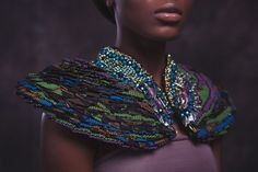 When it comes to extravagant jewelry that has African Influence, no one can rival Anita Quansah's creations. The British Designer never hesitates to tap into her Ghanaian and Nigerian roots for inspiration. Pictured you can see where tradition and modern meet. Beautiful colors such as orange, purple, and blue are intertwined in a mix of…