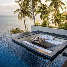Outside Dining Inside a Vanishing Edge Pool Overlooking Ocean - Dream Home