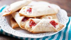 Strawberry jam and cream cheese are wrapped in pie crust to make mini wraps that taste like pie and cheesecake.