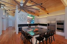 Kitchen with exposed beams and oak ceiling