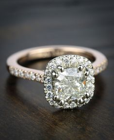 https://www.brilliance.com/recently-purchased-rings/custom-two-tone-cushion-diamond-halo-engagement-ring