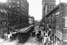 Sixth Avenue in Des Moines, Iowa, 1910: A trolley car shares Sixth Avenue with automobiles and horse drawn wagons in Des Moines, Iowa in 1910