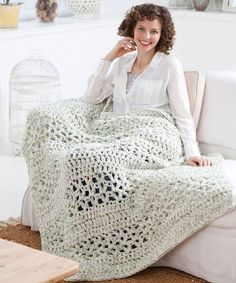 Whip up this crochet afghan pattern for the ultimate lounge blanket. If you& a beginner, build your skills with this quick crochet blanket pattern. Crochet Afghans, Quick Crochet Blanket, Fast Crochet, Afghan Crochet Patterns, Crochet Blankets, Crochet Cushions, Crochet Blocks, Chunky Crochet, Crochet Granny