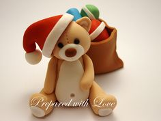 Christmas Teddy with Present Sack Cake Topper, available from www.preparedwithlove.co.uk £10