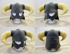 Dovahkiin's Helmet Beanie - A gray beanie that extends down to the eyes like a helmet with two goat horns that extend out the sides pointing down. The horns would be a beige colour. I chose this beanie because I have played the game skyrim, which is where this beanie originates.