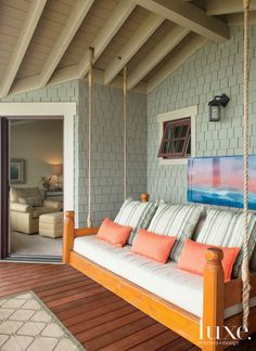 Transitional Sleeping Porch with Colorful Swing