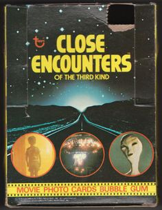 CLOSE ENCOUNTERS OF THE THIRD KIND COMPLETE SET+: 1978, Topps, includes the complete set of cards #1 - 66 and stickers #1 - 11, Average NM, wrapper is in the original pack fold configurations, no tears, stored that way since 1978, and a Wax Pack Box in very good condition, box not flattened, top perforations are punched and the lid 15¢ price tab is missing, scenes from the film on the lid and side panels. All for $37