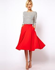 black and white stripes, knee length red skirt, hair up, cork wedges