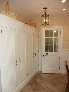enclosed storage - much neater than open cubbies  ~ Click through to Houzz for a stunning large photo ~