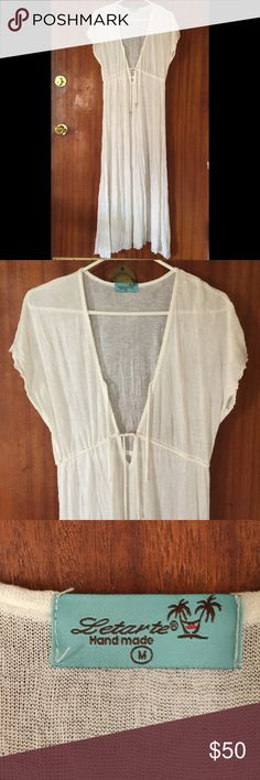 Letarte Handmade Cover Up Size M Delicate white fabric cover-up. Like new. Beautiful shell embellishments on end of Ties. Measures 54 inches from shoulder to hem. Letarte Swim Coverups