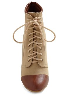 It must be the high laced boot thing that is a throw back to another generation that makes me love these boots
