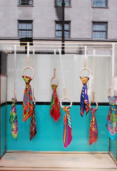 Hanging Hermes scarves. I like the bright and vivid india inspired colours of these scarves.