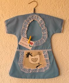 Light blue with amusing chicken on the apron
