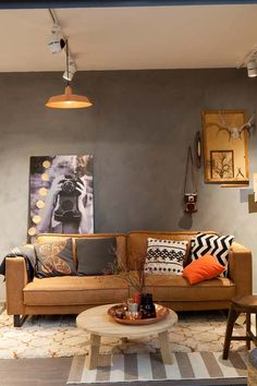neutral graphic rugs. But would need to be darker. This shows 2 rugs layered. Like the bold throw pillows & coffee table