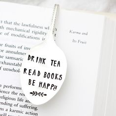 """A flattened vintage spoon becomes a tea lovers bookmark, inscribed with """"Drink Tea, Read Books, Be Happy"""" Your bookmark will have the same lettering and design"""
