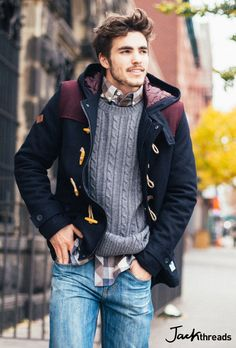 Shop this look on Lookastic:  https://lookastic.com/men/looks/black-duffle-coat-grey-cable-sweater-brown-long-sleeve-shirt-blue-jeans/7476  — Brown Gingham Long Sleeve Shirt  — Grey Cable Sweater  — Black Duffle Coat  — Blue Jeans