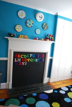 Adore this awesome idea! Totally going to do it for the eaves storage door in the family room. We can't put any furniture in front of it, so may as well make it functional and fun! Unused Fireplace, Fireplace Doors, Paint Fireplace, Fireplace Cover, Fireplace Screens, Faux Fireplace, Baby Proof Fireplace, Fireplace Ideas, Basement Fireplace