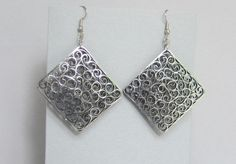 Quilled Earrings, Silver on Black, Paper Filigree. $15.00, via Etsy.