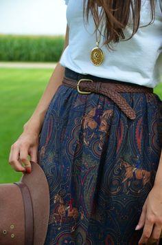 patterned skirt, belt, long necklace