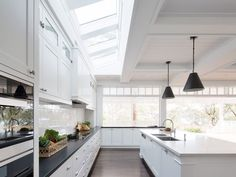 The open plan kitchen of our Mosman project features a large scale custom skylight which brings so much natural light into the space. Hamptons Kitchen, Hamptons House, The Hamptons, Best Kitchen Designs, Modern Kitchen Design, Modern Design, Beach House Kitchens, Cool Kitchens, Open Plan Kitchen