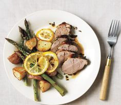 Herb-Rubbed Pork Tenderloin With Potatoes and Lemony Asparagus   Real Simple