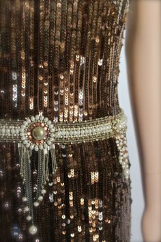 $1,850.00 - REEM ACRA Sequin Metallic Evening Gown 1990s. The mirrored ombre evening gown pays homage to classic Art Deco architecture and its lavish ornamentation. Straight slender cut w/ sequins throughout bodice and full skirt. Faux pearls & beaded band w/ tiered medallions at drop waist. Channels the roaring undertone of the 1920s social scene and its glimmering effect. (hva)