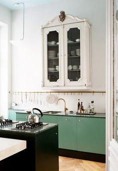 We're a huge fan of hooks in the kitchen - esp lovely copper ones like this.